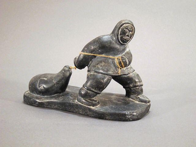 Pauloosie Weetaluktuk, Hunter dragging seal c. 1960-1969, Stone,  sinew