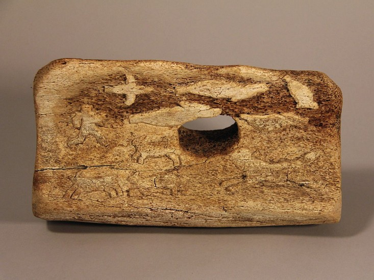 Inuit Anonymous, Whalebone block with low relief carvings of seals, birds, dogs and man on a komatik Whalebone